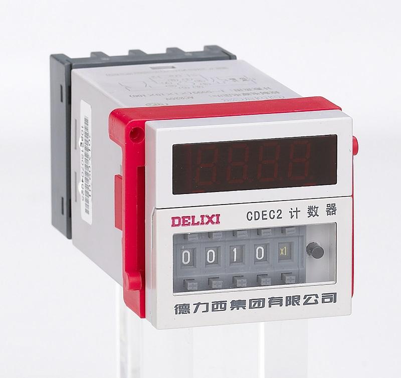 """本系列产品主要由电压变换器、整流稳压器、晶体振荡/分频/计数器、集成电路、拨码开关、及执行继电器等组成的""""元器件组合""""部件和外壳、上插等部件组成。 本系列产品采用集成电路、晶体振荡器,用拨码开关进行计数整定,具有计数准确、计数范围宽、寿命长、功耗小、输出接点容量大、使用方便、显示直观、工作稳定可靠、结构新颖、工艺先进等特点。"""